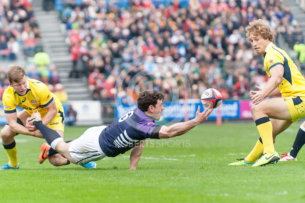 Nick de Luca looks to offload the ball in a tackle, during Scotland's game against Australia. Action from the IRB Emirates Airline Glasgow 7s at Scotstoun in Glasgow. 3 May 2014. (c) Paul J Roberts / Sportpix.org.uk
