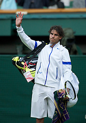 LONDON, ENGLAND - Monday, June 27, 2011: Rafael Nadal (ESP) waves to the fans as he leaves centre court after winning the Gentlemen's Singles 4th Round match on day seven of the Wimbledon Lawn Tennis Championships at the All England Lawn Tennis and Croquet Club. (Pic by David Rawcliffe/Propaganda)