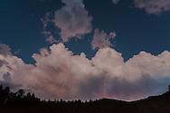 Twilight lightning storm over forest and mountains, Jemez Mounains, NM© 2006 David A. Ponton