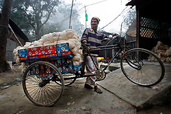 BANGLADESH SIRAJGANJ RADHUNIBARI 31JAN07 - A rikshaw van arrives with a load of unwashed cotton yarn. Records of an indigenous weaving industry based on handlooms producing cotton fabrics date back to the 13th century in this area...jre/Photo by Jiri Rezac..© Jiri Rezac 2007..Contact: +44 (0) 7050 110 417.Mobile:  +44 (0) 7801 337 683.Office:  +44 (0) 20 8968 9635..Email:   jiri@jirirezac.com.Web:    www.jirirezac.com..© All images Jiri Rezac 2007 - All rights reserved.