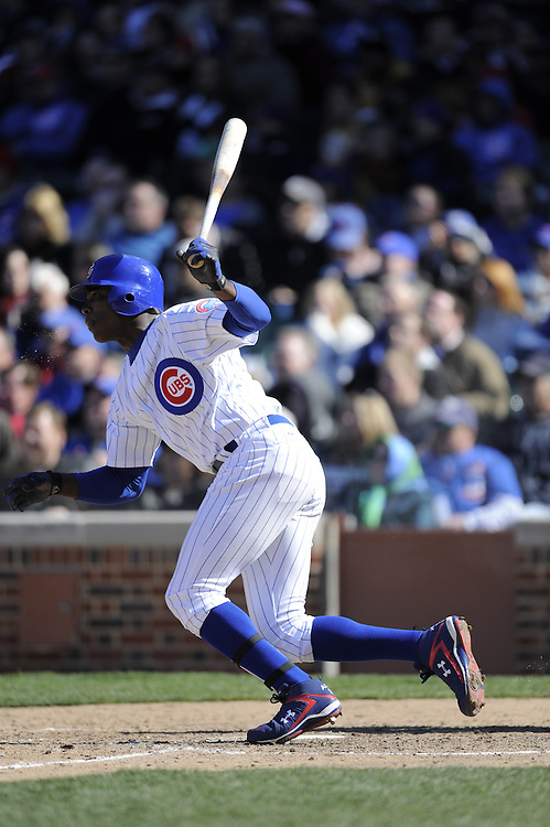 CHICAGO - APRIL 15:  Alfonso Soriano #12 of the Chicago Cubs bats against the Colorado Rockies on April 15, 2009 at Wrigley Field in Chicago, Illinois.  The Rockies defeated the Cubs 5-2.  (Photo by Ron Vesely)