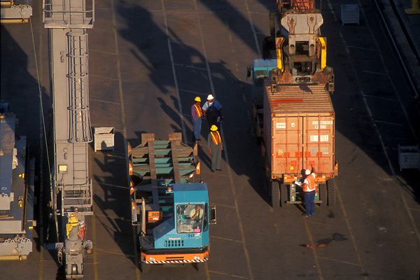Aerial view of transport vehicles being loaded with shipping containers at the Port of Houston