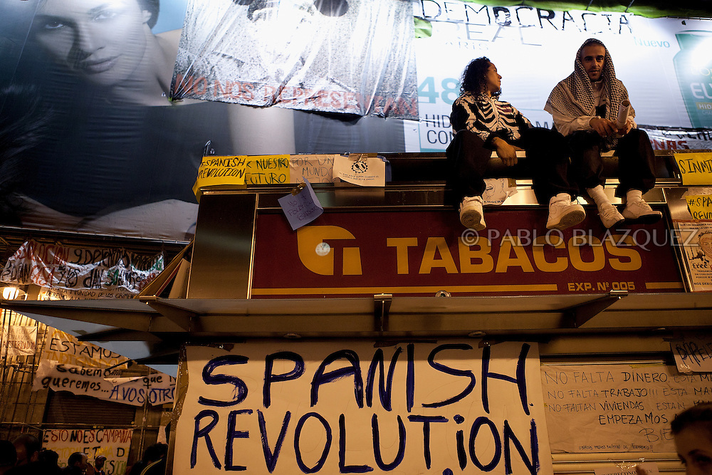 Demonstrators gather at Puerta del Sol Square on May 19, 2011 in Madrid, during protests against Spain's economic crisis and its sky-high jobless rate.Protests over the economic crisis began in Madrid on May 15 and fanned out to city squares nationwide as word spread by Twitter and Facebook among demonstrators known variously as 'the indignant', 'M-15', 'Spanish Revolution' and 'Real Democracy Now'.