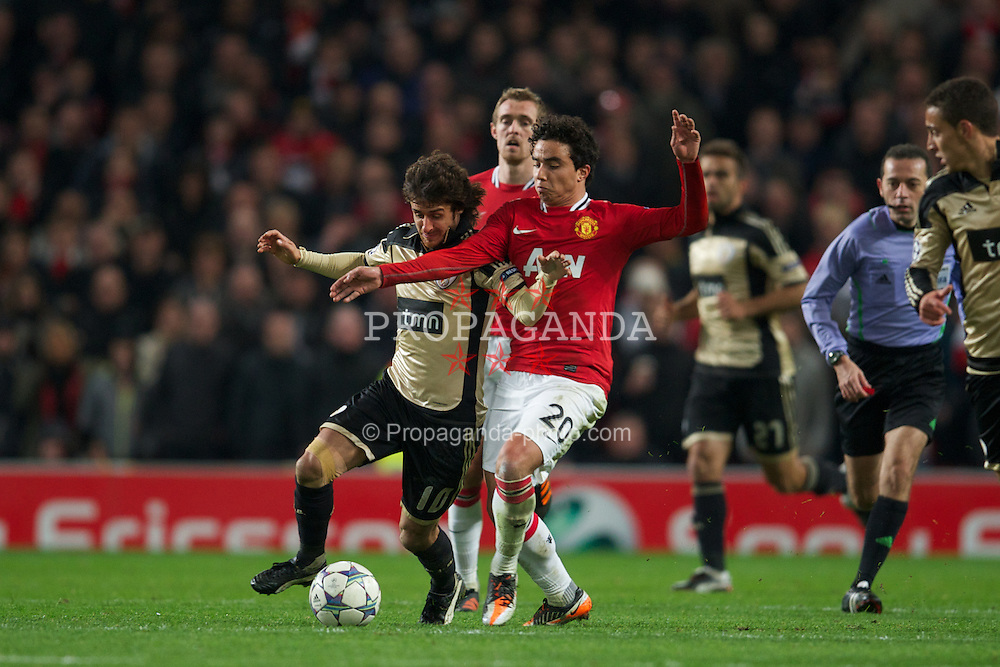 MANCHESTER, ENGLAND - Tuesday, November 22, 2011: Manchester United's Fabio Da Silva in action against SL Benfica's Pablo Aimar during the UEFA Champions League Group C match at Old Trafford. (Pic by David Rawcliffe/Propaganda)