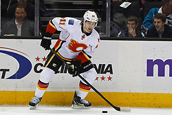 Jan 17, 2012; San Jose, CA, USA; Calgary Flames center Mikael Backlund (11) skates with the puck against the San Jose Sharks during the first period at HP Pavilion. San Jose defeated Calgary 2-1 in shootouts. Mandatory Credit: Jason O. Watson-US PRESSWIRE