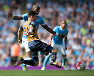 Hector Bellerin of Arsenal (nearest) and Eliaquim Mangala of Manchester City challenge for the ball during the Barclays Premier League match at the Etihad Stadium, Manchester<br /> Picture by Russell Hart/Focus Images Ltd 07791 688 420<br /> 08/05/2016
