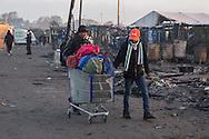 Calais, Pas-de-Calais, France - 27.10.2016    <br />  <br /> Governmental camp destruction on the 4th day of the eviction of the so called &rdquo;Jungle&quot; refugee camp on the outskirts of the French city of Calais. Many thousands of migrants and refugees are waiting in some cases for years in the port city in the hope of being able to cross the English Channel to Britain. French authorities announced a week ago that they will evict the camp where currently up to up to 10,000 people live.<br /> <br /> Beh&ouml;rdlichen Camp-Abriss am vierten Tag der Raeumung des so genannte &rdquo;Jungle&rdquo;-Fluechtlingscamp in der franzoesischen Hafenstadt Calais. Viele tausend Migranten und Fluechtlinge harren teilweise seit Jahren in der Hafenstadt aus in der Hoffnung den Aermelkanal nach Gro&szlig;britannien ueberqueren zu koennen. Die franzoesischen Behoerden kuendigten vor einigen Wochen an, dass sie das Camp, indem derzeit bis zu bis zu 10.000 Menschen leben raeumen werden. <br /> <br /> Photo: Bjoern Kietzmann