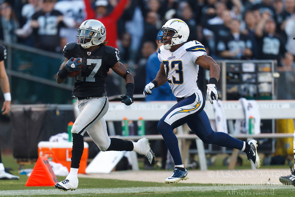 Jan 1, 2012; Oakland, CA, USA; Oakland Raiders wide receiver Denarius Moore (17) rushes past San Diego Chargers cornerback Quentin Jammer (23) on a 76-yard pass reception during the third quarter at O.co Coliseum. San Diego defeated Oakland 38-26. Mandatory Credit: Jason O. Watson-US PRESSWIRE