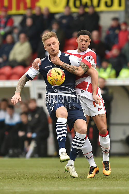 Byron Webster of Millwall FC and Nathan Tyson of Doncaster Rovers fight for the ball  during the Sky Bet League 1 match between Doncaster Rovers and Millwall at the Keepmoat Stadium, Doncaster, England on 27 February 2016. Photo by Ian Lyall.