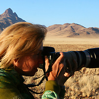 Africa, Namibia, Sossusvlei. Photographer in the Namib Rand.