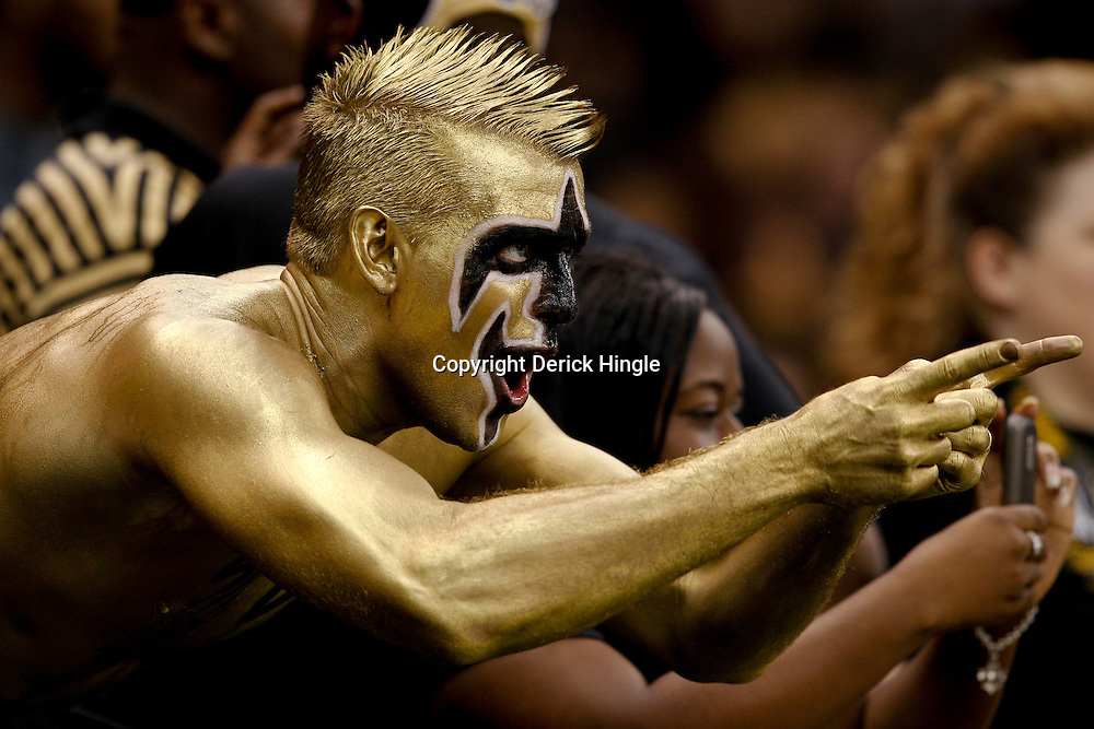 September 9, 2010; New Orleans, LA, USA;  A New Orleans Saints fan cheers prior to kickoff of the NFL Kickoff season opener at the Louisiana Superdome. The New Orleans Saints defeated the Minnesota Vikings 14-9.  Mandatory Credit: Derick E. Hingle