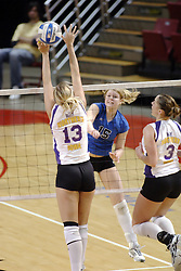 24 November 2006: Sarah Schulze strikes between the hands of Shannon Aschoff during a Semi-final match between the Creighton University Bluejays and the Northern Iowa University Panthers. The Tournament was held at Redbird Arena on the campus of Illinois State University in Normal Illinois.<br />