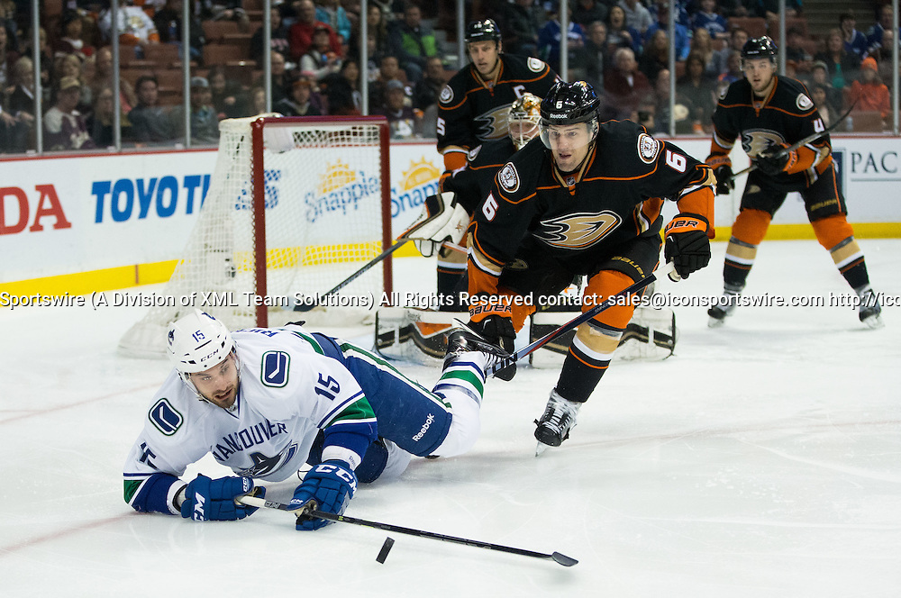 December 28, 2014 - Vancouver Canucks Center Brad Richardson (15) [3528] and Anaheim Ducks Defenceman Ben Lovejoy (6) [6537] fight for the puck during the game between Vancouver Canucks and Anaheim Ducks at Honda Center in Anaheim, CA.