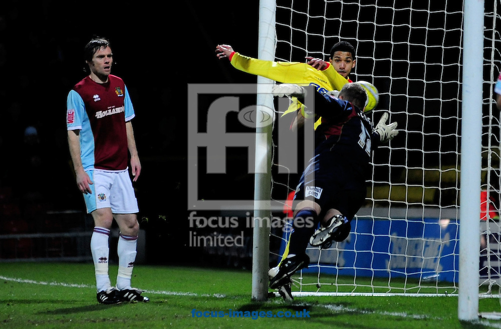London - Tuesday, January 27th, 2009: Jobi McAnuff of Watford scores the first goal past a helpless Brian Jensen of Burnley as Graham Alexender looks on during the Coca Cola Championship match at Vicarage Road, London. (Pic by Daniel Hambury/Focus Images)