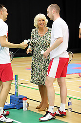 Image licensed to i-Images Picture Agency. 23/07/2014. Glasgow, United Kingdom. The Duchess of Cornwall talks to England badminton players during a visit  to the Commonwealth Games in Glasgow  Picture by Stephen Lock / i-Images