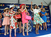 Katrina Dennis, right, of Baltimore, Md., celebrates after winning the Longines Most Elegant Woman at the Preakness contest, Saturday, May 16, 2015, at Pimlico Race Course in Baltimore, Md. Longines, the Swiss watch manufacturer known for its elegant timepieces, is the Official Watch and Timekeeper of the 140th annual Preakness Stakes and the Triple Crown. (Photo by Diane Bondareff/Invision for Longines/AP Images)