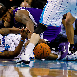 December 15, 2010; New Orleans Hornets guard Marcus Thornton (5) and Sacramento Kings power forward DeMarcus Cousins (15) scramble for a loose ball during the second half at the New Orleans Arena. The Hornets defeated the Kings 94-91. Mandatory Credit: Derick E. Hingle