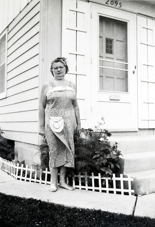 adult woman standing by the house ca 1970s