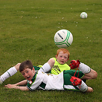 Dillon Downes and Daragh Miniter showing some of their skill at the FAI summer soccer camp in Gallery Park in Kilrush during the week.<br /> Photograph by Yvonne Vaughan