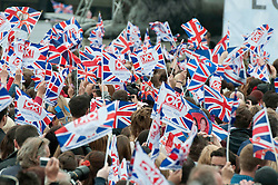 LONDON, UK  29/04/2011. The Royal Wedding of HRH Prince William to Kate Middleton. Crowds gather in Trafalgar Square in central London, to celebrate the marrige of HRH Prince William and Katherine Middleton. Photo credit should read MICHAEL GRAAE/LNP. Please see special instructions. © under license to London News Pictures