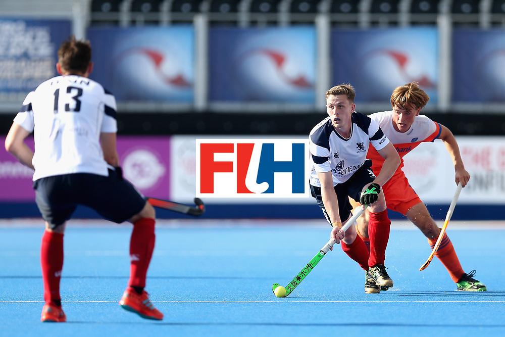 LONDON, ENGLAND - JUNE 17: Michael Bremner of Scotland runs past Jorrit Croon of the Netherlands during the Hero Hockey World League Semi Final match between Scotland and Netherlands at Lee Valley Hockey and Tennis Centre on June 17, 2017 in London, England.  (Photo by Alex Morton/Getty Images)