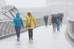 © Licensed to London News Pictures. 26/08/2015. London, UK. Tourists and visitors crossing Millennium Bridge in London during heavy rain and wet weather today. Photo credit : Vickie Flores/LNP
