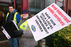 PCS members and supporters in Sheffield stage an eight-hour demonstration to protest  against the planned closure of the local office of the Driver and Vehicle Licensing Agency (DVLA). The protest was called to coincide with a visit to the premises by transport minister Mike Penning.on Monday (23 January) but according to Mike Mackie, assistant secretary of the PCS northern branch for the DVLA, the visit was canceled within 15 minutes of the Sheffield Demo being announced on the PCS website..Mike Mackie and Lauraine Compton.www.pauldaviddrabble.co.uk..23 January 2012 -  Image © Paul David Drabble