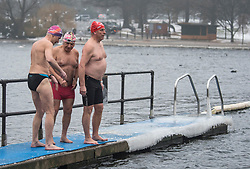 © Licensed to London News Pictures. 03/03/2018. London, UK. Members of the Serpentine Swimming Club prepare to brave freezing overnight temperatures as they enjoy an early morning dip at sunrise in the Serpentine in Hyde Park, London. Large parts of the UK are recovering from a week of sub zero temperatures and heavy snowfall, following two severe cold fronts. Photo credit: Ben Cawthra/LNP