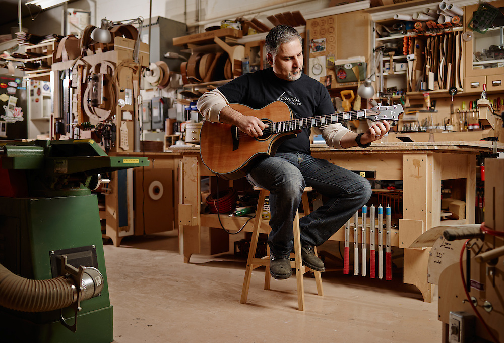 Craftsman  testin g out one of his custom hand made acoustic guitar in his workshop Shot on a PhaseOne IQ180 as a Environmental Portrait.
