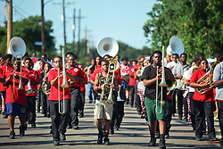 26 August 2015. New Orleans, Louisiana. <br /> Hurricane Katrina revisited. <br /> Rebuilding the Lower 9th Ward a decade later. <br /> local schoolchildren from the Martin Luther King Jr high school practice with their marching band on thew eve of a visit from President Obama.<br /> Photo credit©; Charlie Varley/varleypix.com.