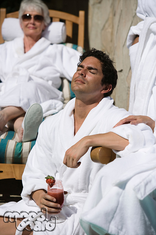 People in bathrobes, relaxing outdoors