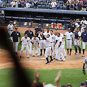 Brett Gardner, New York Yankees, rounds the bases after hitting a walk off home run in the bottom of the ninth  during the New York Yankees V Detroit Tigers Major League Baseball regular season baseball game at Yankee Stadium, The Bronx, New York. 11th August 2013. Photo Tim Clayton