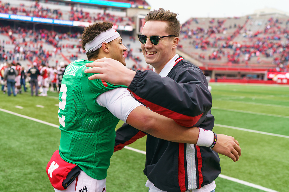 Adrian Martinez #2 hugs former teammate Patrick O'Brien during Nebraska's annual Spring Game at Memorial Stadium in Lincoln, Neb., on April 21, 2018. © Aaron Babcock