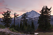 Mount Baker (Komo Kulshan) as the sun sets on the Mount Baker-Snoqualmie National Forest of Washington State. Photographed in the fall, just before the first snow, from Huntoon Point on Kulshan Ridge.