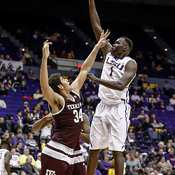 Feb 4, 2017; Baton Rouge, LA, USA; LSU Tigers forward Duop Reath (1) shoots over Texas A&M Aggies center Tyler Davis (34) during the second half at the Pete Maravich Assembly Center. Texas A&M defeated LSU 85-73. Mandatory Credit: Derick E. Hingle-USA TODAY Sports