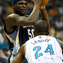 April 1, 2011; New Orleans, LA, USA; Memphis Grizzlies power forward Zach Randolph (50) is guarded by New Orleans Hornets power forward Carl Landry (24) during the first half at the New Orleans Arena.    Mandatory Credit: Derick E. Hingle