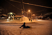 A man slides on his snowboard down the main street in Hirafu, a village that is part of the Niseko ski resort in Hokkaido, northern Japan on Feb. 5 2010. An average of 15 meters of snow falls in the Niseko region each winter.