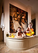 Liam and Oscar (glasses) Storkerson (sp?), in bathroom of their grandfather Brian Burns Palm Beach home.