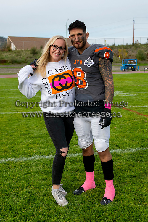 KELOWNA, BC - OCTOBER 6: Kian Ishani #8 of Okanagan Sun poses with a fan on the field after the win against the VI Raiders at the Apple Bowl on October 6, 2019 in Kelowna, Canada. (Photo by Marissa Baecker/Shoot the Breeze)