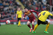Billy Knott (Bradford) pushes the ball out wide for another bradford attack during the The FA Cup match between Bradford City and Chesham FC at the Coral Windows Stadium, Bradford, England on 6 December 2015. Photo by Mark P Doherty.