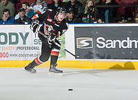 KELOWNA, CANADA, JANUARY 1: Peter Kosterman #4 of the Calgary Hitmen makes a pass as the Calgary Hitmen visit the Kelowna Rockets on January 1, 2012 at Prospera Place in Kelowna, British Columbia, Canada (Photo by Marissa Baecker/Getty Images) *** Local Caption ***