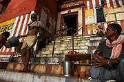 As the sun rises over the Ganges, Kedar Ghat is bathed in warm sunlight, Varanasi, Uttar Pradesh