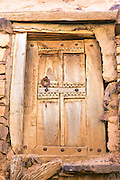 Close up of an old door to a storage chamber inside the Ighrem Granary, Souss Massa Draa, Southern Morocco, 2016-05-26.&nbsp;<br /><br />The Ighrem &lsquo;agadir&rsquo; (singular form of granary in Tamazert Amazigh dialect) is a fortified Berber collective granary.<br /><br />The granary structures (Igoudar - plural form of granary in the Tamazert Amazigh dialect) weren&rsquo;t only built for storing harvests, medicines and possessions; the Amazigh ancestors also constructed them to function as an ancient form of a 'high security bank vault.&rsquo;&nbsp;<br />The Anti Atlas and the Souss ranges are no strangers to war and conflict. The mountain terrains have been home to many an Amazigh uprising against the central governments during Arab rule and early French Occupation.<br />Although each granary is unique in design, their bee hive like labyrinth interiors of interconnecting tunnels, ladders and passageways holding padlocked chambers collectively resemble a style of architecture that Tolkien might have imagined.<br /><br />Most of the igoudar that remain are thought to date to the 16th and 17th century, although the tradition of building and using collective granaries is estimated to be as old as a millennia.&nbsp;<br /><br />One year of low rainfall can make life very difficult for the mainly self sufficient populous of the Anti Atlas range, who would have been ever more dependent upon the fruits of their harvest during the time of structures development.<br /><br />The crops which are agriculturally viable amid the dramatic climate conditions of the Anti Atlas, such as saffron, almonds, and argan are high in value, with saffron only offering a short annual harvesting window and the stigmas needing optimum storage conditions to preserve life span. <br /><br />Everything from important documents, money and jewellery to the seasons harvest could be stored inside the locked chambers. These well ventilated, shaded rooms built from thick stone walls remain at cool tem