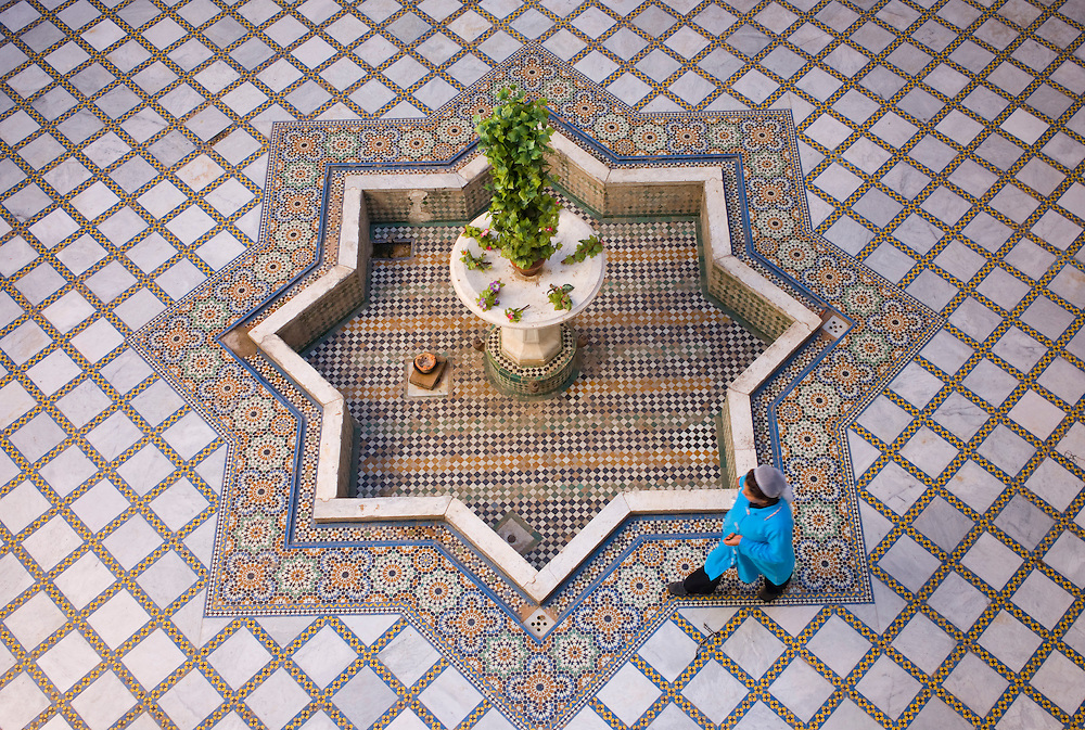 Woman passing by in a patio inside El Moqri Palace in Fez Medina.