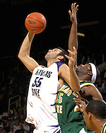 Kansas State center Jason Bennett (55) pulls a rebound away from Cleveland State's Renard Fields (45) in the second half at Bramlage Coliseum in Manhattan, Kansas, December 5, 2006.  K-State beat the Vikings 93-60.<br />