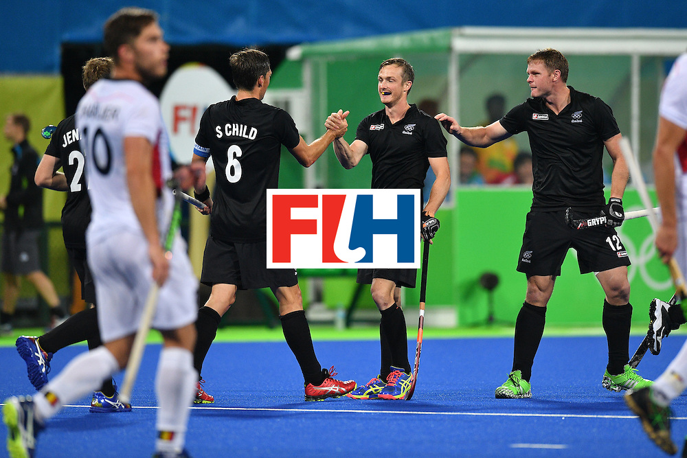 New Zealand's Hugo Inglis (C) celebrates scoring a goal during the mens's field hockey Belgium vs New Zealand match of the Rio 2016 Olympics Games at the Olympic Hockey Centre in Rio de Janeiro on August, 12 2016. / AFP / Carl DE SOUZA        (Photo credit should read CARL DE SOUZA/AFP/Getty Images)