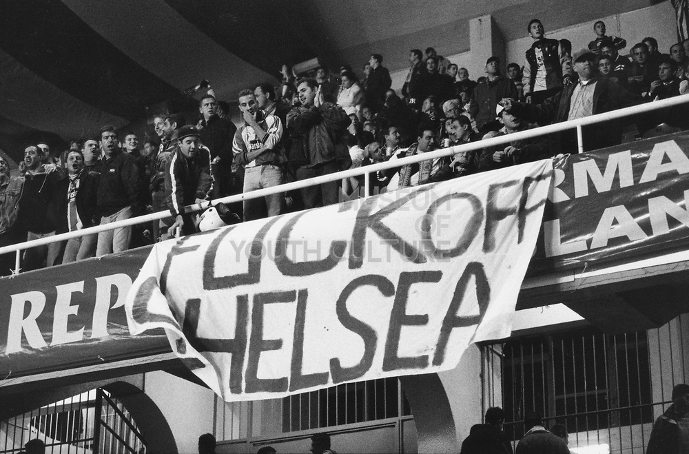 Football fans with a 'Fuck off Chelsea' banner
