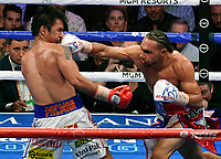 LAS VEGAS, NEVADA - JULY 20. <br /> Manny Pacquiao (L) takes a hit by Keith Thurman during their fight for the WBA welterweight title fight at MGM Grand Garden Arena on July 20, 2019 in Las Vegas, Nevada. Pacquiao went 12 rounds and took the win by a split decision.  (MB Media)