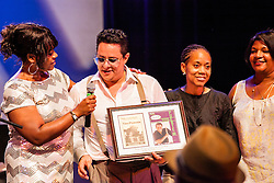 Tito Puente, Jr. and his Orchestra perform at the Reichhold Center of the Arts.  Puente's performance marks 25 years and 3 days since his father, renowned Latin jazz and salsa musician performed on this same stage for a Virgin Islands audience.  Director Nissa N. Copemann, vice-President for Institutional Advancement Dionne V Jackson, and First Lady Cecile deJongh present Tito with a gift commemorating the occasion.  Tito Puente, Jr. nurtures his father's musical legacy by performing the classic compositions for which he was known.  throughout © Aisha-Zakiya Boyd