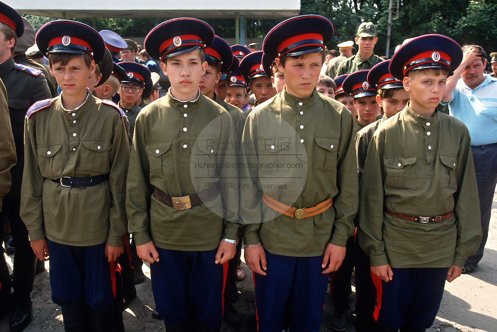 Young Russian Don Cossacks stand at attention before marching in a parade at the Don Cossack Military School in Novocherkassk, Russia. The students are participating in the annual Cossack Festival gathering of units from around Russia.